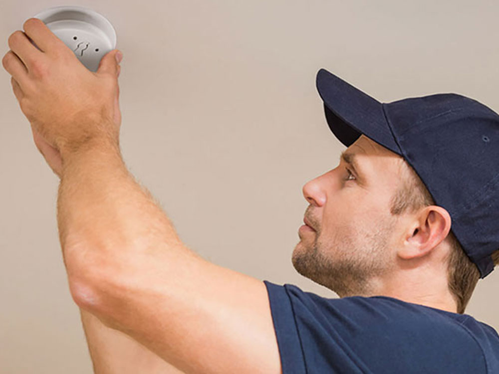 Electrician installing PDL Fire alarm