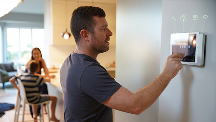 Man using Smart Home devices
