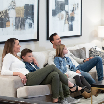Family in Smart Home watching TV